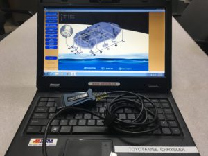 OBD II Data Link Connector & laptop for automotive diagnosis